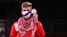 Olympics-Taekwondo-Jordan's silver medallist happy for Russian friend's gold