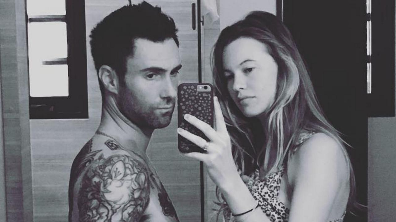 Adam levine snaps sweet pic with wife behati prinsloo jokes hes adam levine snaps sweet pic with wife behati prinsloo jokes hes pregnant too im finally popping nvjuhfo Images