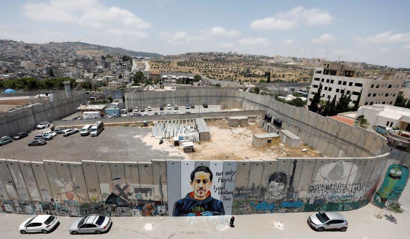 A mural depicting Iyad al-Halaq is seen painted on the Israeli barrier in Bethlehem in the Israeli-occupied West Bank
