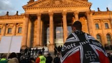 Germany politicians condemn far-right flags outside parliament