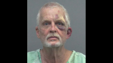 He was mad at his neighbor's parking. He beat the neighbor, his dog with ax handle, cops say