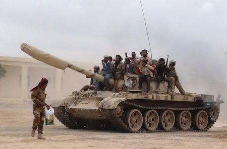 Southern People's Resistance militants loyal to Yemen's President Abd-Rabbu Mansour Hadi move a tank from the al-Anad air base in the country's southern province of Lahej