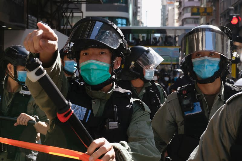 Riot police ask people to leave to avoid mass gathering during a protest against the looming national security legislation in Hong Kong