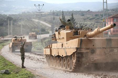 A Turkish military convoy arrives at a village on the Turkish-Syrian border in Kilis province, Turkey. REUTERS/Stringer