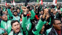 Indonesian motorcycle taxi drivers protest low online tariffs