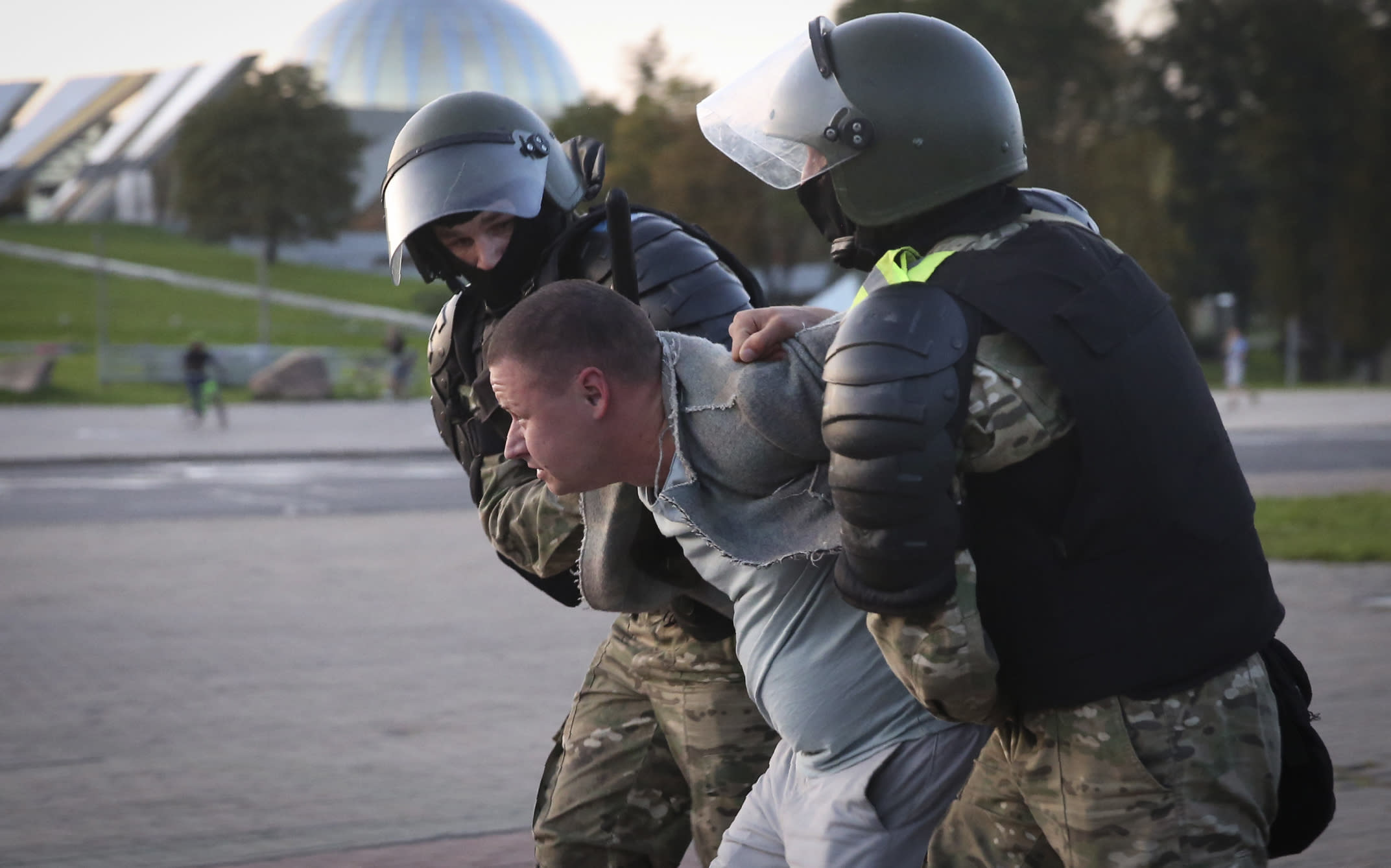 Riot police detain a protester during an opposition rally to protest the presidential inauguration in Minsk, Belarus, Wednesday, Sept. 23, 2020. Belarus President Alexander Lukashenko has been sworn in to his sixth term in office at an inaugural ceremony that was not announced in advance amid weeks of huge protests saying the authoritarian leader's reelection was rigged. Hundreds took to the streets in several cities in the evening to protest the inauguration. (AP Photo/TUT.by)