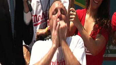 In hot dog contest, eating champs still top dogs