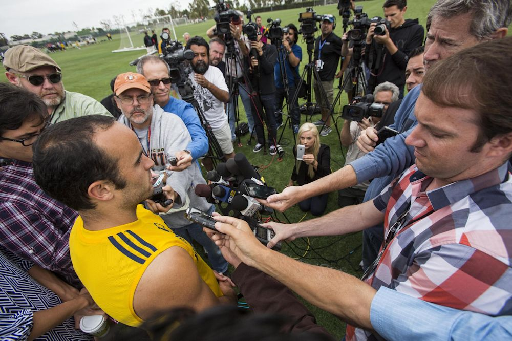 Los Angeles Galaxy forward Landon Donovan talks to media after a soccer training session at StubHub Center in Carson, Calif., Saturday, May 24, 2014.  Donovan, the most accomplished American player in the history of men's soccer, won't be going to his fourth World Cup. The 32-year-old attacker was among seven players cut Thursday when coach Jurgen Klinsmann got down to the 23-man limit well before the June 2 deadline