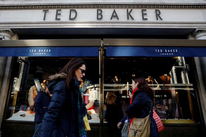 bebdf84f4095c8 FILE PHOTO  Shoppers walk past a Ted Baker store on Regents Street in London