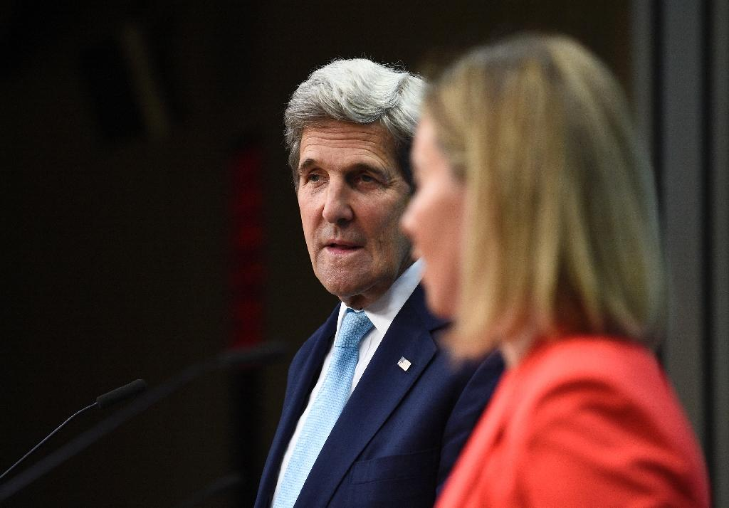 US Secretary of State John Kerry holds a joint press conference with EU foreign affairs head Federica Mogherini in Brussels on July 18, 2016 (AFP Photo/John Thys)