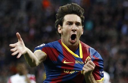Barcelona's Messi celebrates after scoring against Manchester United during their Champions League final soccer match at Wembley Stadium in London