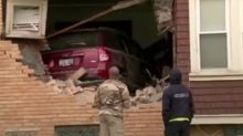 Watch the moments after a Jeep Compass crashes into a house in Milwaukee