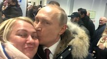 Pucker up! Vladimir Putin kisses female supporter on the campaign trail