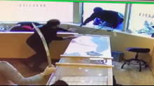 Video shows jewelry store clerks fending off would-be robbers with swords