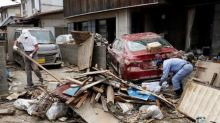 Japan struggles to restore water to flood-hit towns