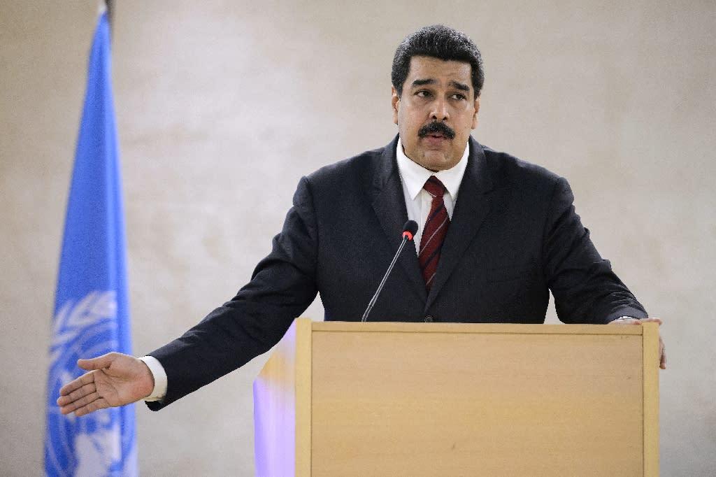 Venezuela's President Nicolas Maduro gestures as he addresses the UN human rights council in Geneva on November 12, 2015 (AFP Photo/Fabrice Coffrini)