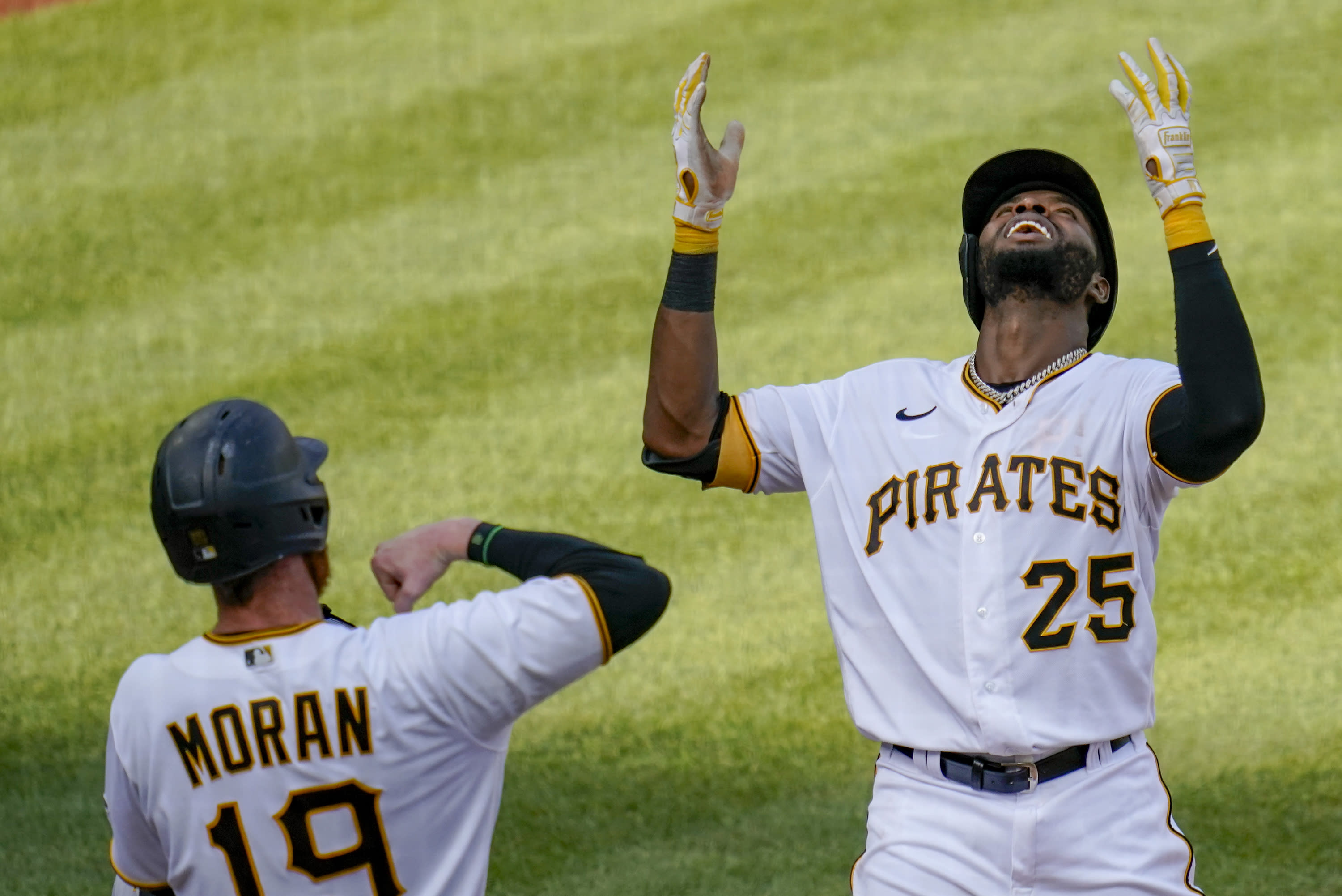 Pittsburgh Pirates' Gregory Polanco, right, celebrates with Colin Moran (19) after driving Moran in with a two-run home run against the Milwaukee Brewers in the fourth inning of a baseball game, Saturday, Aug. 22, 2020, in Pittsburgh. (AP Photo/Keith Srakocic)