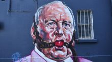 Mural shows Alan Jones gagged by red ball