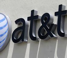 New record high for the NASDAQ as AT&T, Caterpillar stocks dip