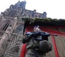 French police hunt gunman after Christmas market attack