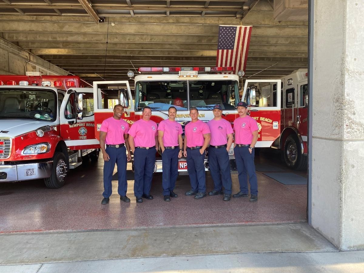 See a Newport Beach Firefighter sporting a pink t-shirt in October? It's their part to raise breast cancer awareness all month long.