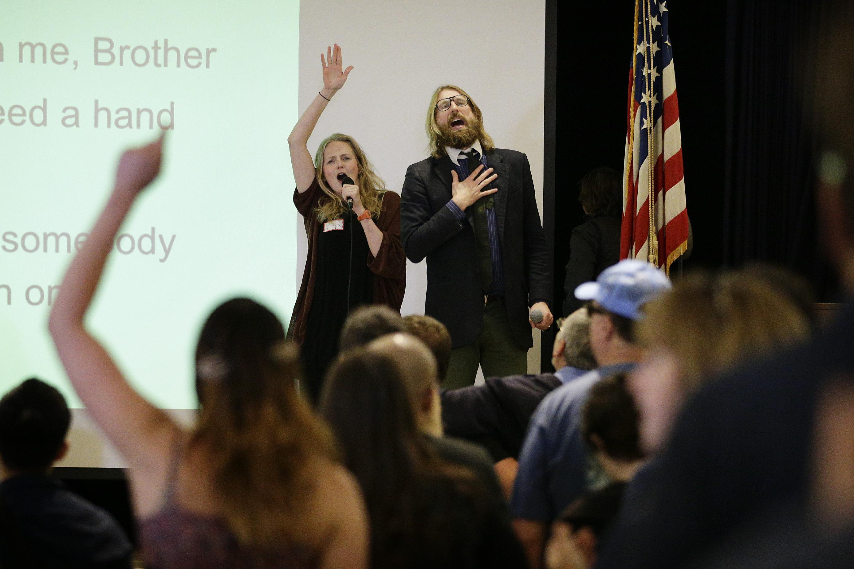 British comedians and co-founders of the Sunday Assembly, Sanderson Jones, right, and Pippa Evans sing a song at the Sunday Assembly on Sunday, Nov. 10, 2013, in Los Angeles. A new mega-church movement is generating buzz from London to Los Angeles, but this time it's a belief in non-belief that's drawing crowds on Sunday mornings. Sunday Assembly began in London in January and soared in popularity among atheists looking for a place to air their views with other likeminded people and now the concept has taken hold across the pond. (AP Photo/Jae C. Hong)
