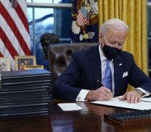 Biden signs executive orders reversing Trump decisions on COVID, climate change