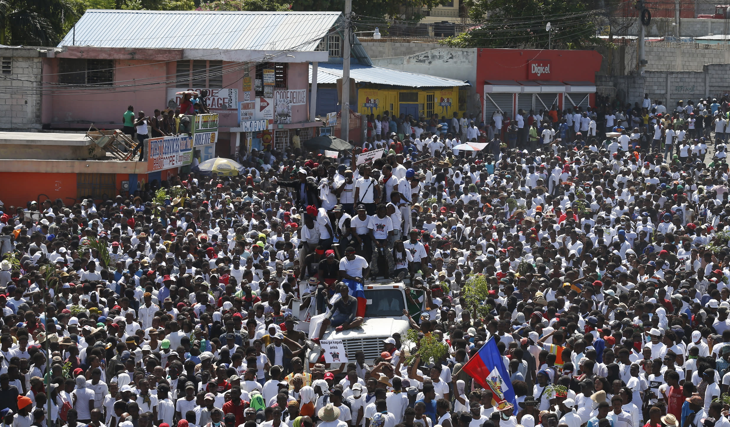 Protesters led by the art community demand the resignation of Haitian President Jovenel Moise as they march through Port-au-Prince, Haiti, Sunday, Oct. 13, 2019. Protests have paralyzed the country for nearly a month, shuttering businesses and schools. (AP Photo/Rebecca Blackwell)