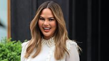 Chrissy Teigen Says She Might Get Breast Reduction Surgery Now That She's Removed Her Implants