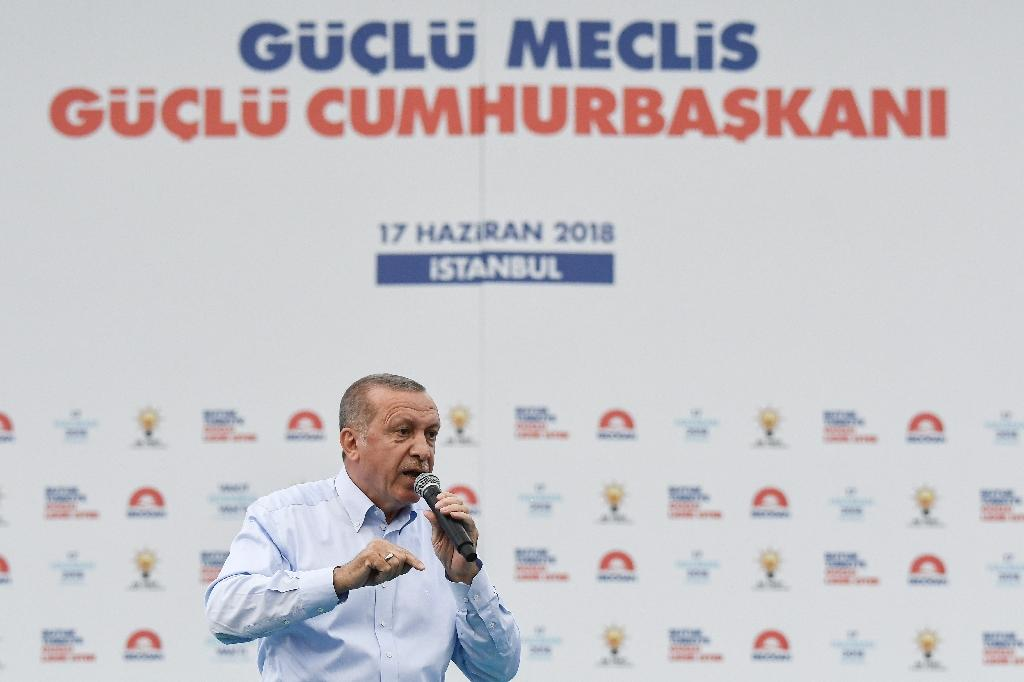 Turkey's President Recep Tayyip Erdogan gives a speech to party supporters during a rally in Yenikapi Square in Istanbul