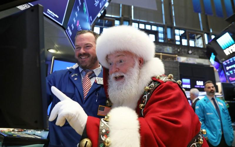 FILE PHOTO: Santa Claus pays a visit on the floor at the New York Stock Exchange (NYSE) in New York