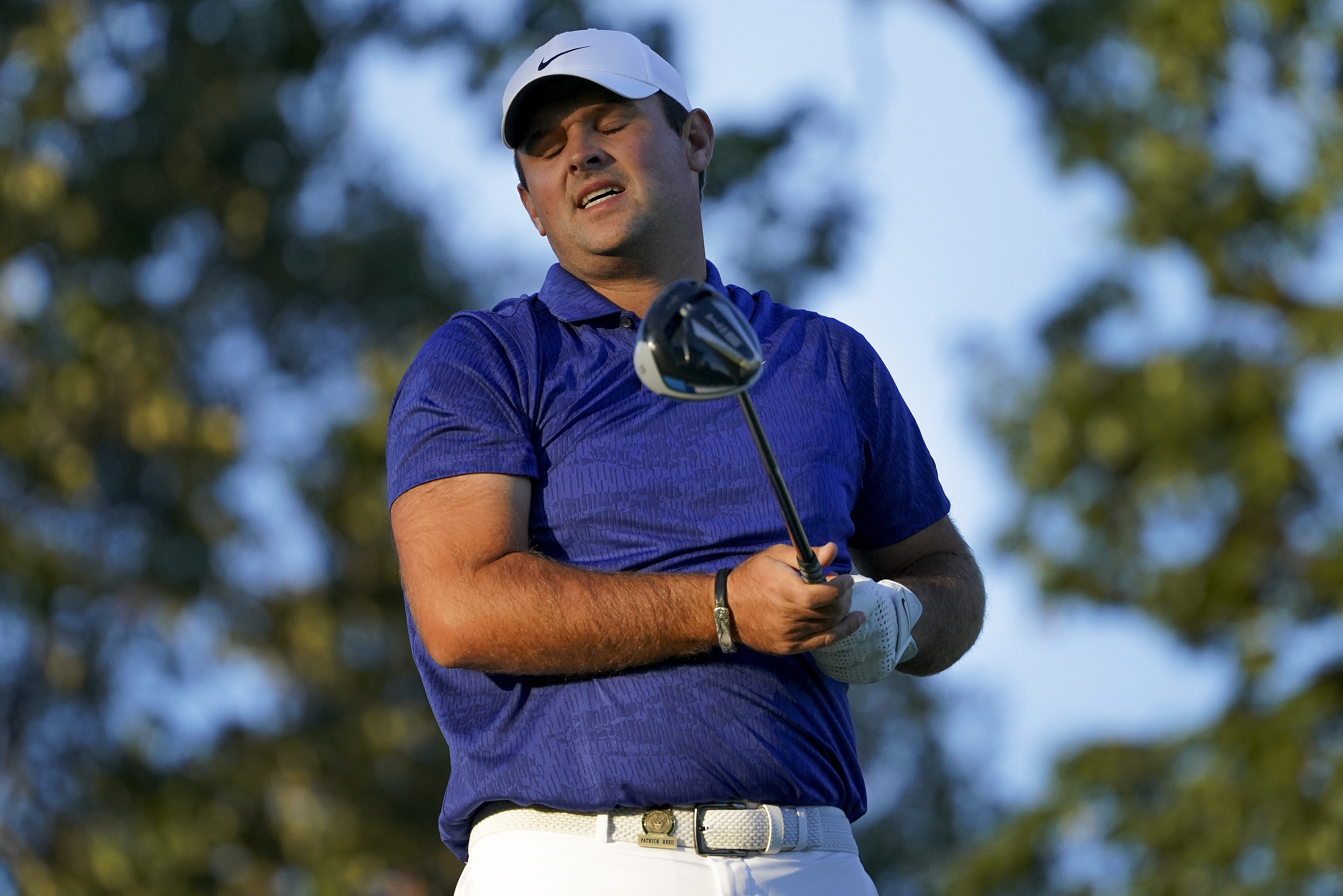 Patrick Reed, of the United States, reacts after playing his shot from the 17th tee during the third round of the US Open Golf Championship, Saturday, Sept. 19, 2020, in Mamaroneck, N.Y. (AP Photo/John Minchillo)
