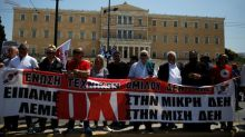 Greek MPs allow power plant sales, government says not selling family silver