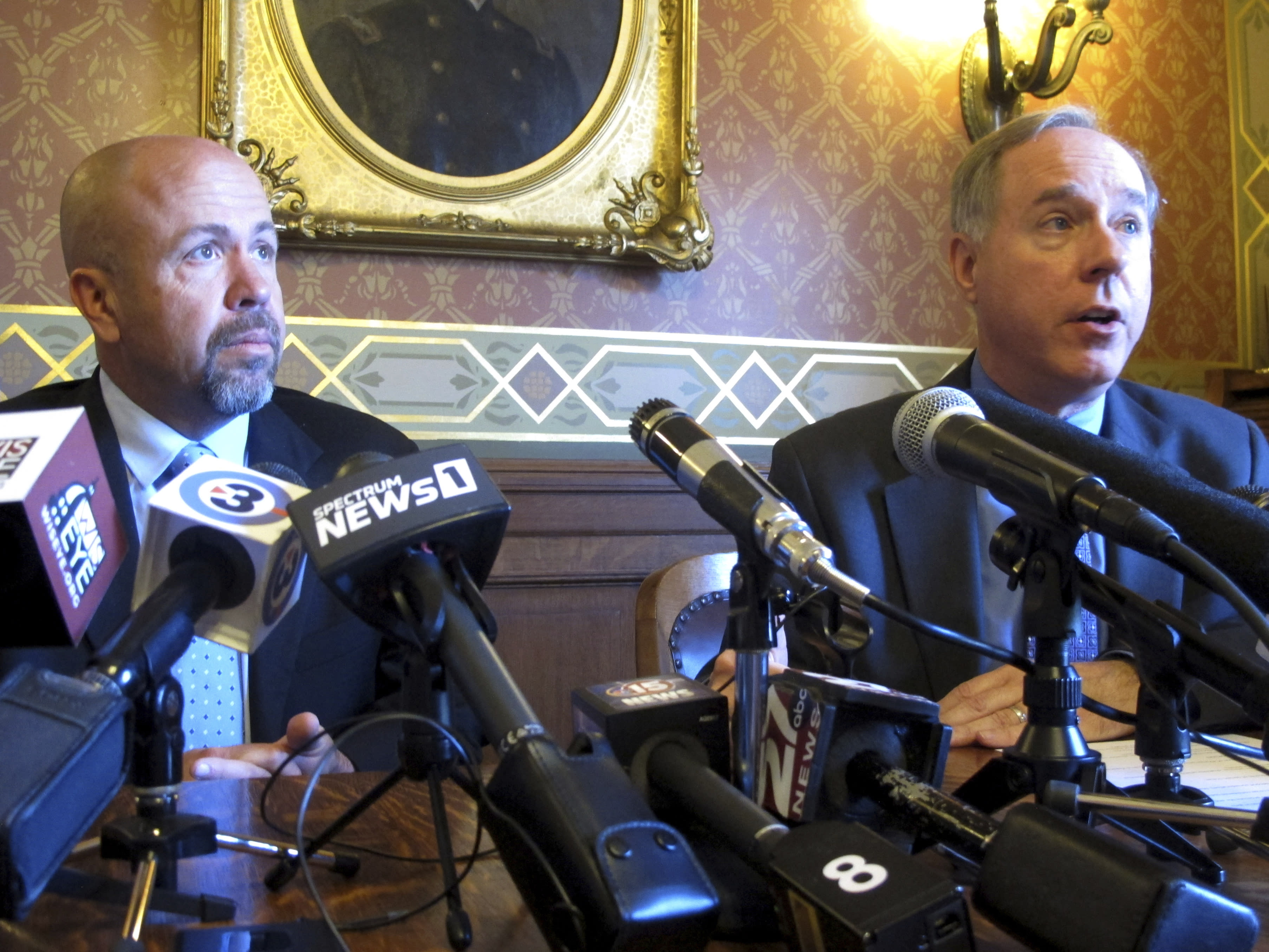 FILE - In this May 15, 2019 file photo, Wisconsin Republican Assembly Speaker Robin Vos, right, and Majority Leader Jim Steineke, left, speak in Madison, Wis. Wisconsin's Republican Assembly leaders are breaking with President Donald Trump over possibly delaying the Nov. 3, 2020 presidential election. Speaker Vos and Majority Leader Steineke tweeted Thursday, July 30, 2020, that they oppose delaying the election, a date that is enshrined in federal law and would require an act of Congress to change, including agreement from the Democratic-controlled House of Representatives. (AP Photo/Scott Bauer File)