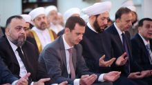 Assad leads prayers in rare appearance outside Damascus