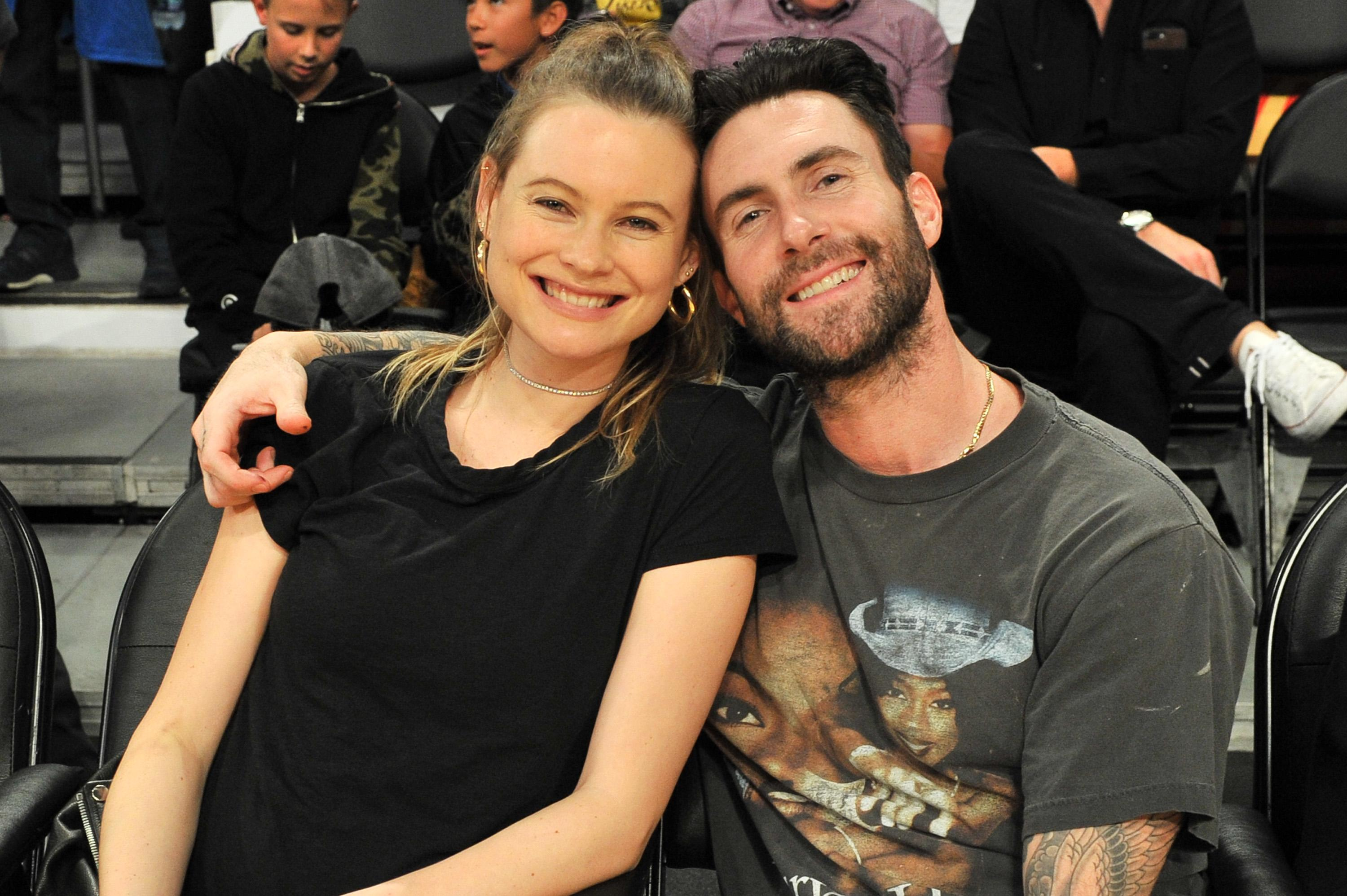 Adam levine and behati prinsloo have welcomed their second child behati prinsloo and singer adam levine attend a basketball game between the los angeles lakers and the philadelphia 76ers at staples center on november 15 nvjuhfo Images