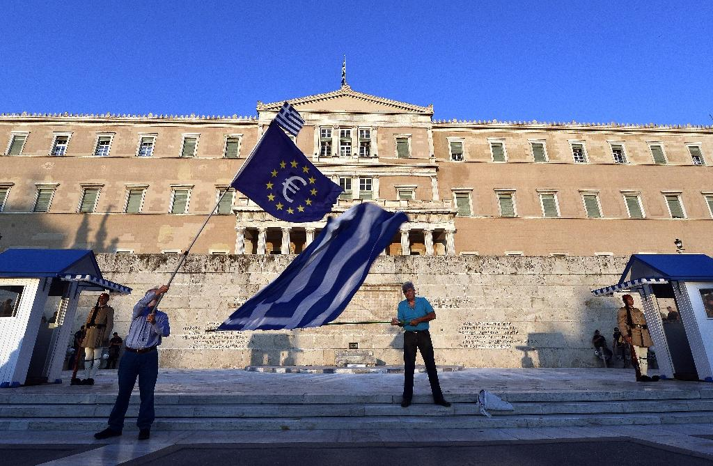 Months of bickering have delayed progress on Greece's 86-billion-euro bailout program agreed in 2015 (AFP Photo/LOUISA GOULIAMAKI)