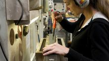 Economy speeds up slightly in March, leading indicators show