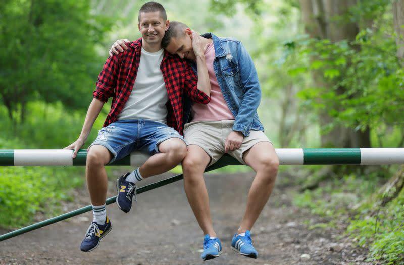 Gay married couple Dawid Mycek and Jakub Kwiecinski pose for a photograph in Hel