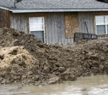 The Latest: Forecasters: 'historic' flooding could hit South