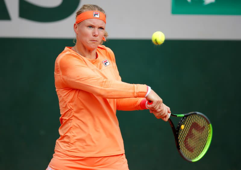 Cramping Bertens leaves court in wheelchair after beating Errani