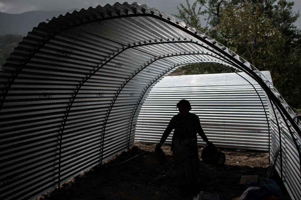 The $100 shelter, which layers corrugated galvanised iron (CGI) sheets over a semi-circular metal frame, can comfortably house a family of four and takes less than an hour to erect (AFP Photo/Philippe Lopez)