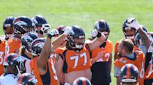 Behold the belly: Pregnant Broncos fan pays homage to rookie center's famous gut