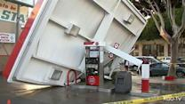 Storm-toppled tree crushes gas station awning