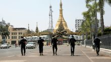 Asia virus latest: Myanmar reports first death, China factory turnaround