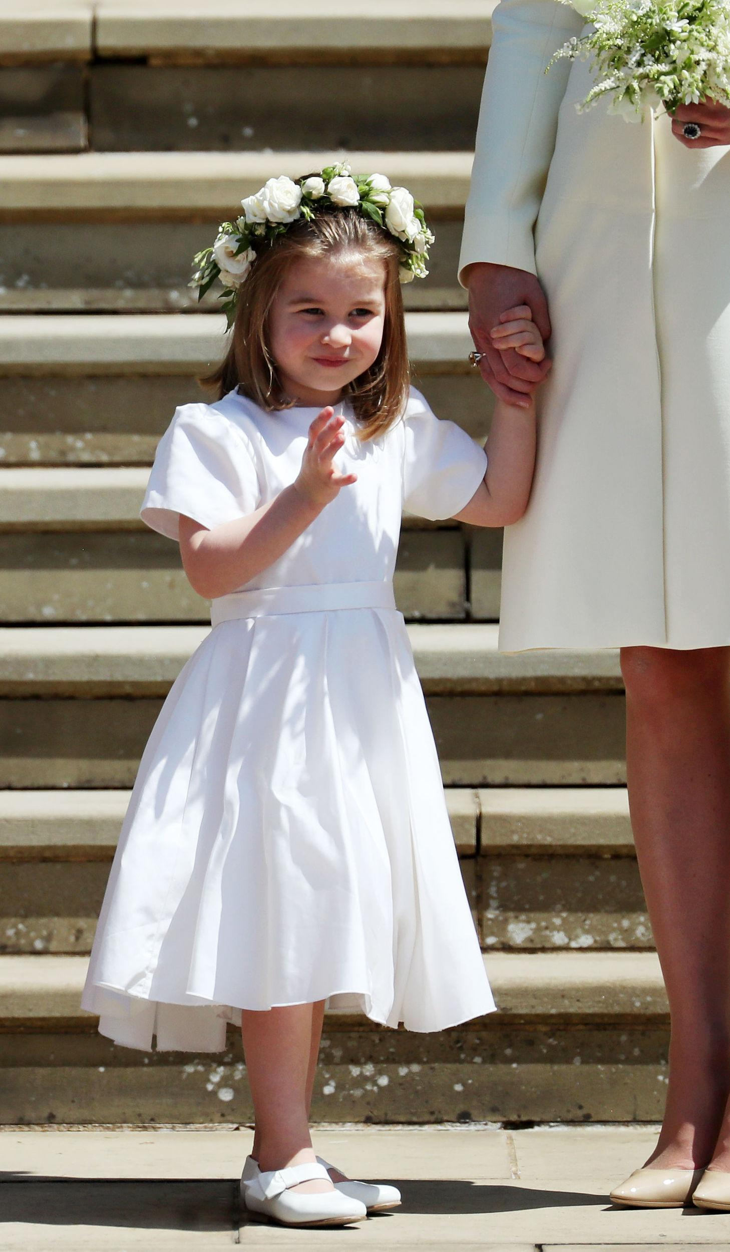 <p>Princess Charlotte on the steps of St George's Chapel after the wedding of Prince Harry and Meghan Markle in St George's Chapel at Windsor Castle on May 19, 2018 in Windsor, England.</p>  <p>(Photo by Jane Barlow - WPA Pool/Getty Images)</p>