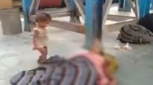 Toddler tries to wake up dead mother at Bihar railway station brings out hardships of migrant worker