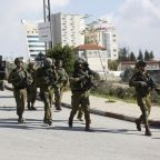 Israeli officials: 7 wounded in shooting near settlement