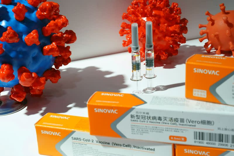 FILE PHOTO: Booth displaying coronavirus vaccine candidate from Sinovac Biotech Ltd in Beijing