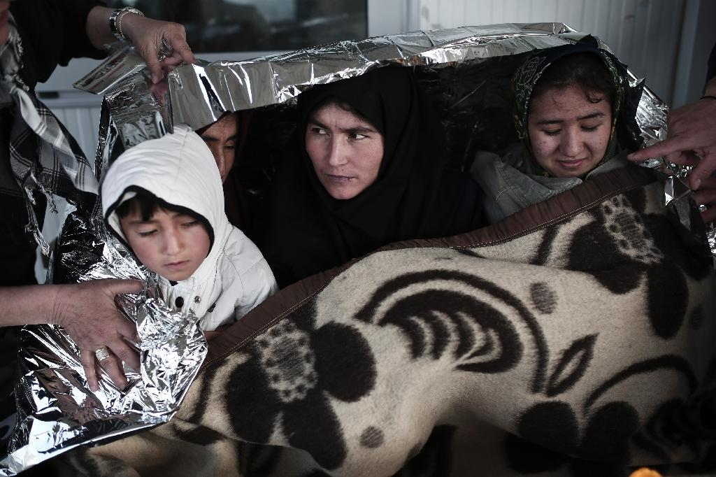 Immigrants arrive at the island of Lesbos on April 18, 2015 (AFP Photo/Angelos Tzortzinis)